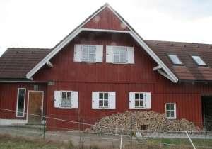 Holzfassade mit färbiger Holzschutz-Lasur