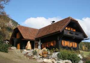 Sanierung Fassade und Holzfenster